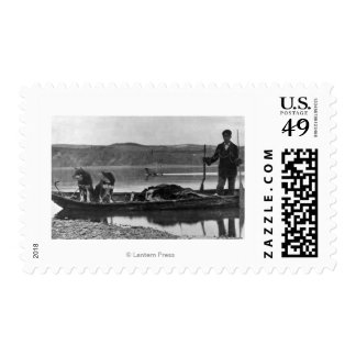 Trapper in Canoe with Hides and Dogs Alaska Postage