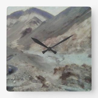 Traveling through rough mountainous terrain square wall clock