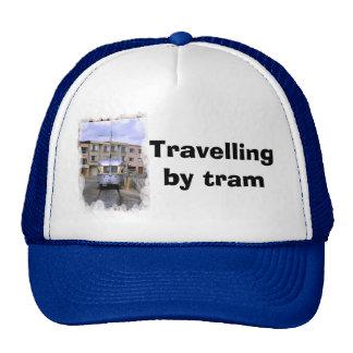 Travelling by tram trucker hat