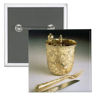 Travelling set of a knife, fork, spoon and beaker, button