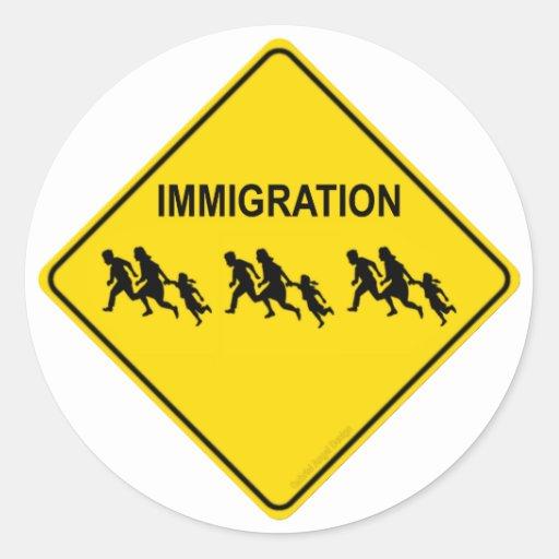 Travesía de la inmigración etiqueta redonda