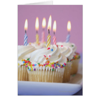 Tray of birthday cupcakes with candles card