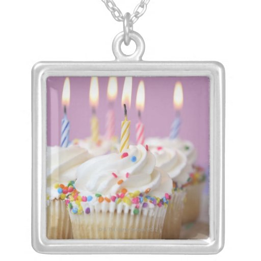 Tray of birthday cupcakes with candles necklace