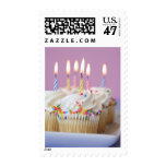 Tray of birthday cupcakes with candles postage stamp