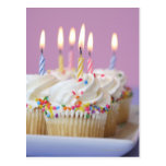 Tray of birthday cupcakes with candles postcard
