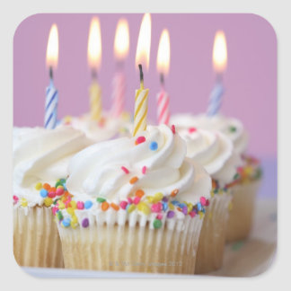 Tray of birthday cupcakes with candles sticker