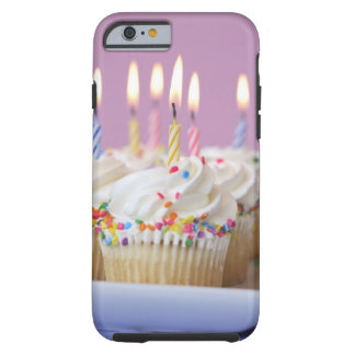 Tray of birthday cupcakes with candles tough iPhone 6 case