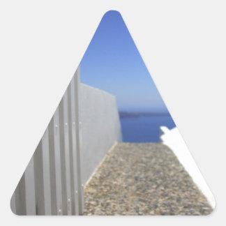 Trayectoria hacia fuera al mar pegatina triangular