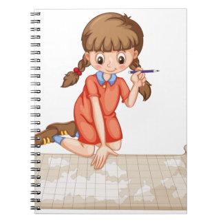 Trazado del chica en mapa note book