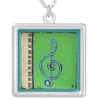 treble clef and keyboard necklace
