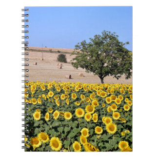 Tree among sunflowers spiral note book
