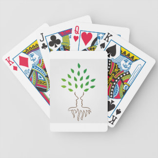 Tree and roots forming the face of a woman bicycle playing cards