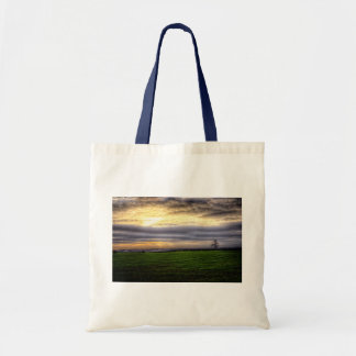Tree at sunset tote bag