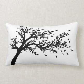 Tree blowing in the wind throw pillows