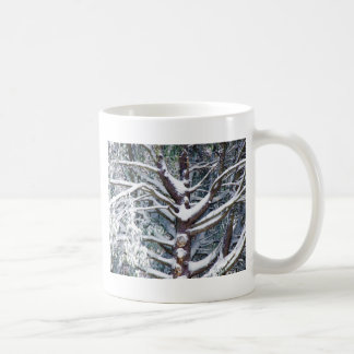 Tree branches covered by snow in winter coffee mug