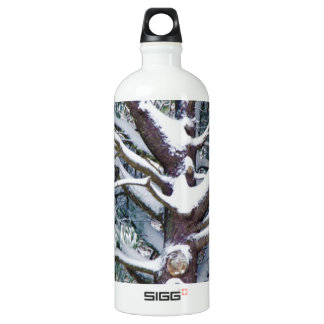 Tree branches covered by snow in winter SIGG traveler 1.0L water bottle