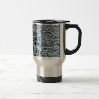 Tree branches covered by snow travel mug