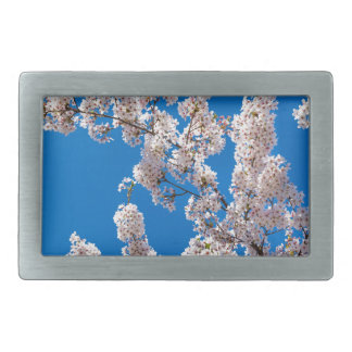 Tree branches with blooming white flowers rectangular belt buckle
