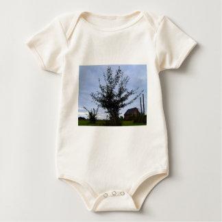 Tree Bush against the blue sky Baby Bodysuit