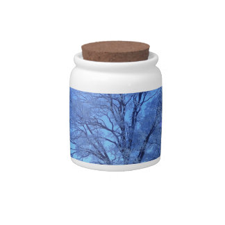 Tree covered in snow on barren landscape candy jars