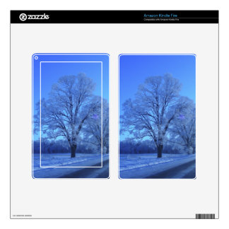 Tree covered in snow on barren landscape. decals for kindle fire