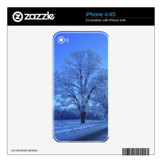 Tree covered in snow on barren landscape. decal for the iPhone 4