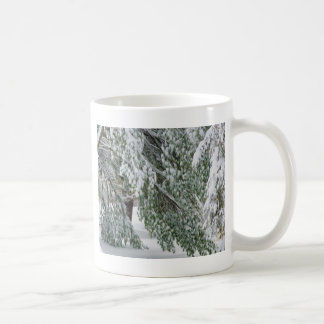 Tree covered with heavy snow coffee mug