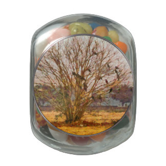 Tree full of large birds glass candy jars