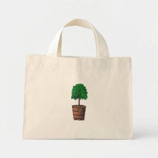 Tree graphic in wooden barrel bucket tote bags