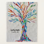 """Tree Of Life Rainbow Colors Custom 2022 Planner<br><div class=""""desc"""">This unique Planner is decorated with a brightly coloured Tree Life on a pale gray background. The original design was made in mosaic using tiny pieces of brightly colored glass. Customize it with your name and year. Original mosaic ©Michele Davies.</div>"""