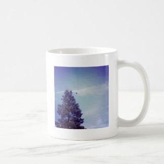 Tree sky clouds bird coffee mug