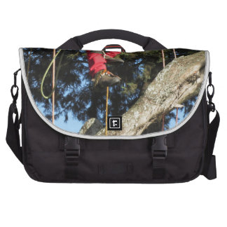 Tree surgeon lumberjack hanging from a big tree bags for laptop