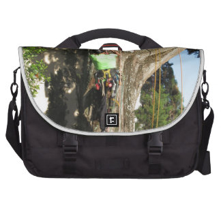 Tree surgeon lumberjack hanging from a big tree commuter bags
