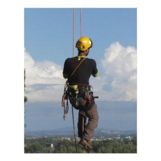 Tree surgeon lumberjack hanging from a big tree letterhead