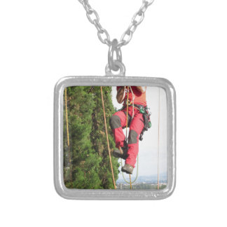 Tree surgeon lumberjack hanging from a big tree silver plated necklace