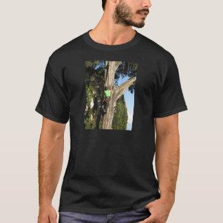 Tree surgeon lumberjack hanging from a big tree T-Shirt