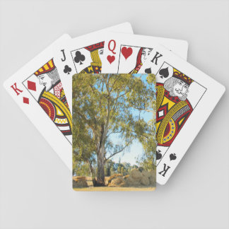 Tree with hay bales playing cards