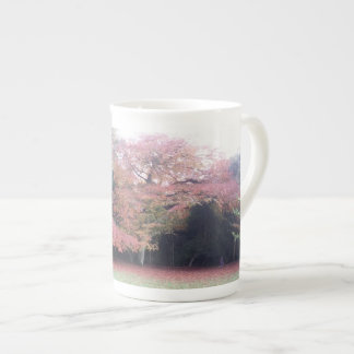 Tree with pink leaves autumn garden colours tea cup