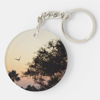 trees and flying bird against florida sunset keychains