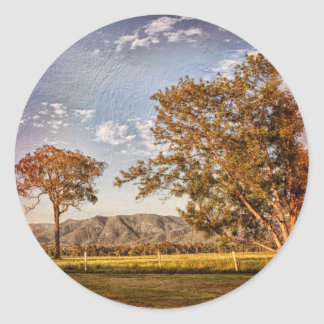 Trees and hills in the country side classic round sticker
