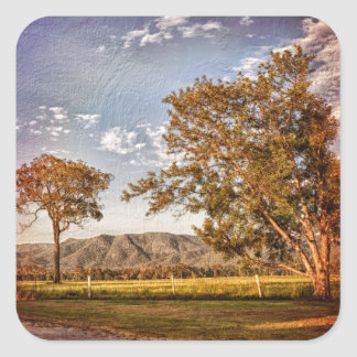 Trees and hills in the country side. square sticker