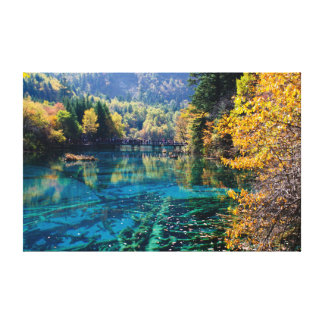 Trees at the bottom of clear blue lake canvas print