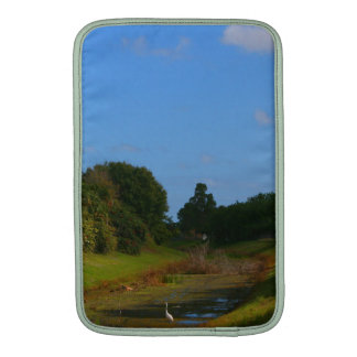 Trees blue sky small stream photograph in Florida MacBook Air Sleeves