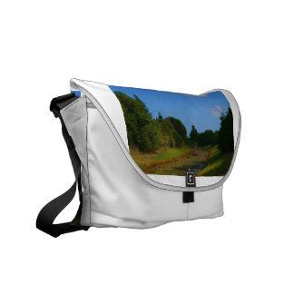 Trees blue sky small stream photograph in Florida Commuter Bags