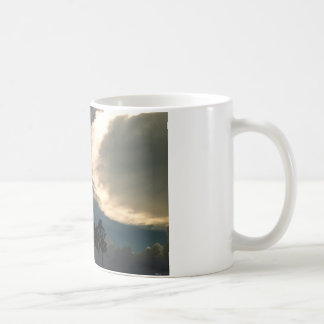 Trees in clouds coffee mug