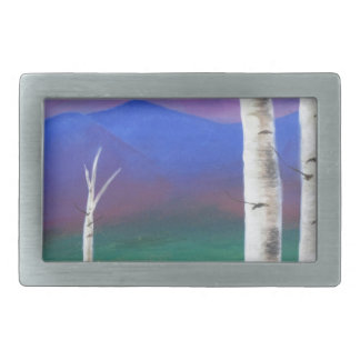 Trees in front of mountians at Sunset Belt Buckle
