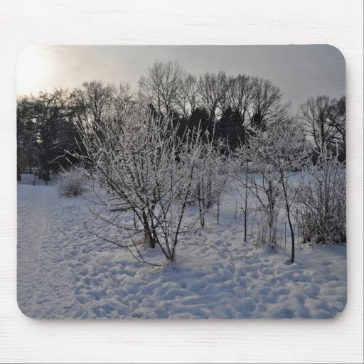 Trees in snow at sunset mouse pad