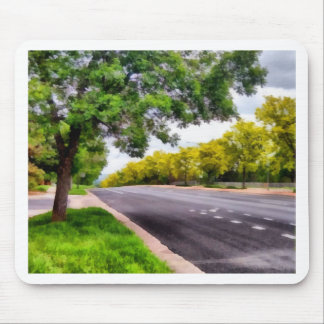 Trees on both sides of a road mouse pad