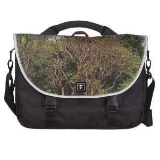 Trees shedding leaves in autumn commuter bag