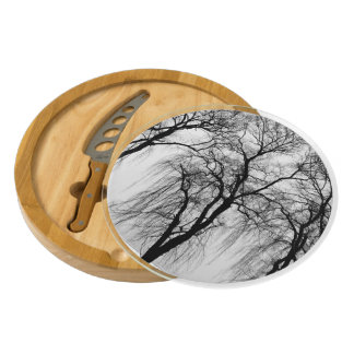 Trees silhouettes in winter round cheese board